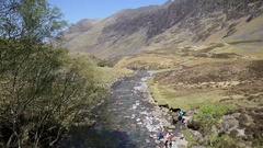 Glencoe river Clachaig Scotland UK with mountains with people Stock Footage