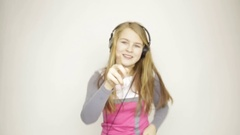 Young girl listening music on headphones and funy dancing Stock Footage