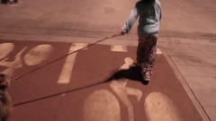 A young girl walks and plays with her dog, slow motion. Arkistovideo