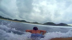 POV of a surfer getting tubed inside a wave while surfing, slow motion. Stock Footage