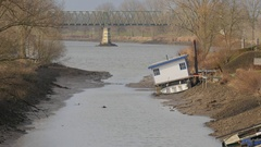 Low water in maas with houseboat in mud,Mook,Netherlands Stock Footage