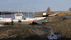 Low water in maas with ferry,Cuijk,Netherlands Stock Footage