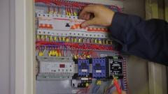Electrician hands checking circuit breakers in electrical fuse box Stock Footage