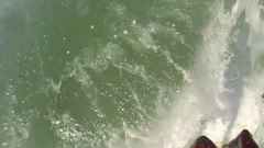 POV of a surfer riding a wave while surfing, slow motion. Stock Footage