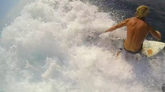 POV following a surfer riding a wave while surfing, slow motion. Stock Footage