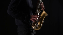Men hands of a professional musician playing on the saxophone Stock Footage