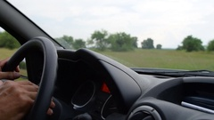 Man driving a car outside the city Stock Footage