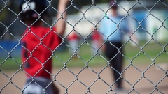 A boy is at bat while playing little league baseball, slow motion. Stock Footage