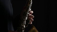 Man's fingers playing on the saxophone beautiful blues melody. Closeup Stock Footage