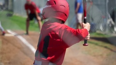 A boy at bat while playing little league baseball, slow motion. Stock Footage