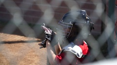 Close-up of a boy playing catcher for a little league baseball team, slow motion Stock Footage