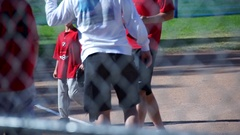 The coach gives a high-five to a boy playing little league baseball, slow motion Stock Footage