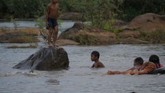 SLOW MOTION Kids jumping and playing in river,Tad Lo,Bolaven,Laos Stock Footage