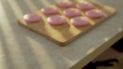 "Macaroon decorated with hearts and the words ""love"" for 14 February Stock Footage"