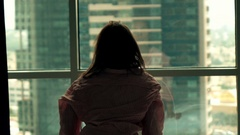 Awake woman in shirt admire view form window at home, super slow motion 240fps Stock Footage