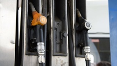 Man placing fueling nozzle on holder Stock Footage