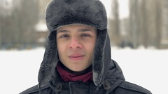 Portrait of young man on the street; snowy weather, slow motion 2 Stock Footage