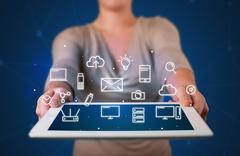 Woman holding tablet with media graphics Stock Photos