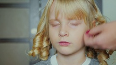 Ny blonde girl combed bangs. We are preparing for a children's holiday Stock Footage