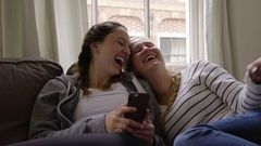 Friends Laugh Really Hard At Something Funny On Smart Phone Stock Footage