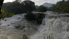 SLOW MOTION Tad Hang waterfall wide view,Tad Lo,Bolaven,Laos Stock Footage