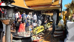 People respect pray and visit gold chedi of Wat Phra That Doi Suthep Stock Footage
