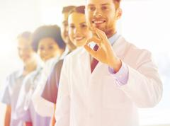Close up of doctors showing ok sign at hospital Stock Photos