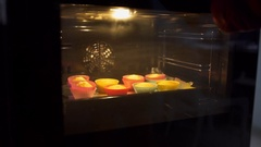 Baker makes cupcakes, housewife bakes, cooking in the kitchen Stock Footage