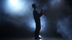 Slow motive on the saxophone. Musician in a smoky studio Stock Footage