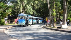 Thai people driving tramcar for send and receive traveler people Stock Footage