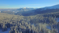 Aerial. Flying above winter mountains. Snow landscape. Beautiful house. 4K Arkistovideo