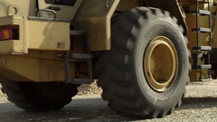 Wheel loader driving back with wood chips in its bucket Stock Footage