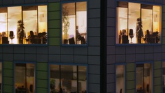 Windows light up in the house. Fragment of the layout of the building Stock Footage