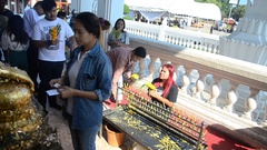 Asian thai people praying and respect with Luang Pho Phet at Wat Tha Luang Stock Footage