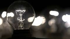 Flashing lamp bulb; light glowing incandescent filament . Detail of incandescent Stock Footage