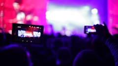 Making video with tablet and smartphone at live music concert Stock Footage