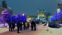 People walking on Maidan Independence Square in front of Christmas decorations Stock Footage