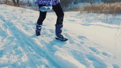 Happy child have fun running on the fresh snow. Laughing happily, positive Stock Footage