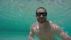 Man taking a selfie in a Pool in Queensland, Australia Stock Footage