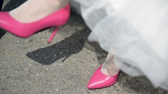 Bride in pink wedding shoes Stock Footage