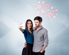 Couple in love taking selfie with red heart Stock Photos