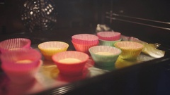 Cupcakes in the oven, baker makes cupcakes, housewife bakes, cooking in the Stock Footage