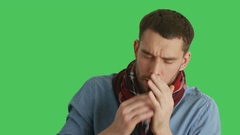 Mid Closeup Shot of a Sick Man in Scarf Caughing and Sneezing.  Stock Footage