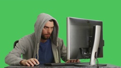 Mid Shot of a Gamer Playing Games at His Desktop. Background is green Screen. Stock Footage