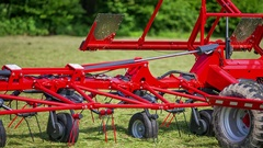 Rotary rakes are lowering down to the ground Stock Footage