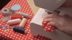 Woman sews on the sewing machine Stock Footage