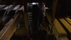 Low Angle Shot Of Gear Turning Inside Windmill Stock Footage