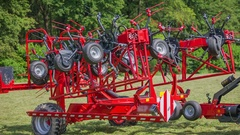 Agricultural machinery is opening and a farmer will start working Stock Footage