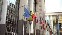 Brussels, Belgium - December 30, 2016: EU flags on glass walls of Berlaymont Stock Footage