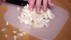Cutting onion for salad close up Stock Footage
